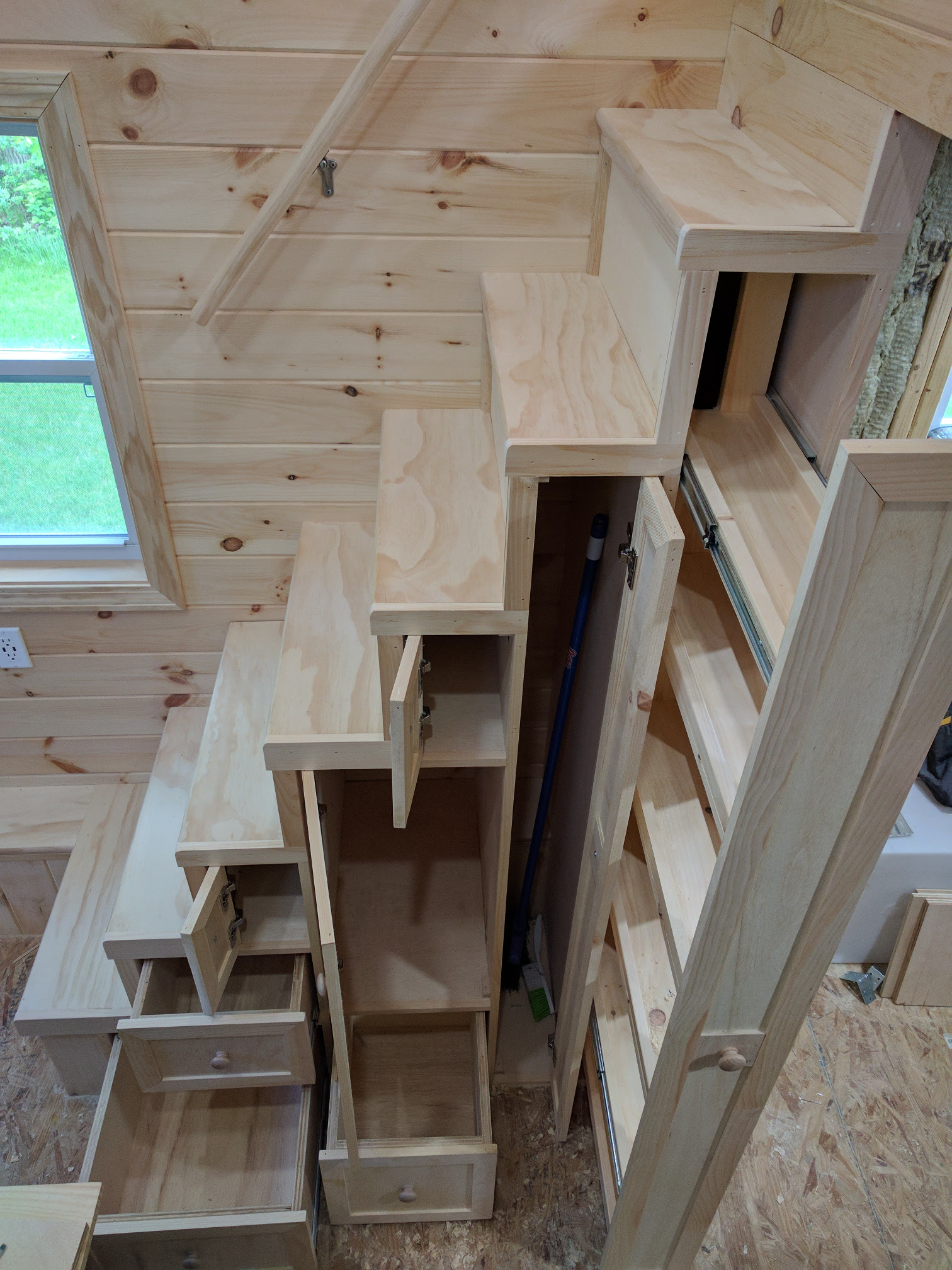 Tiny House Stairs With Storage Shelves And Pantry